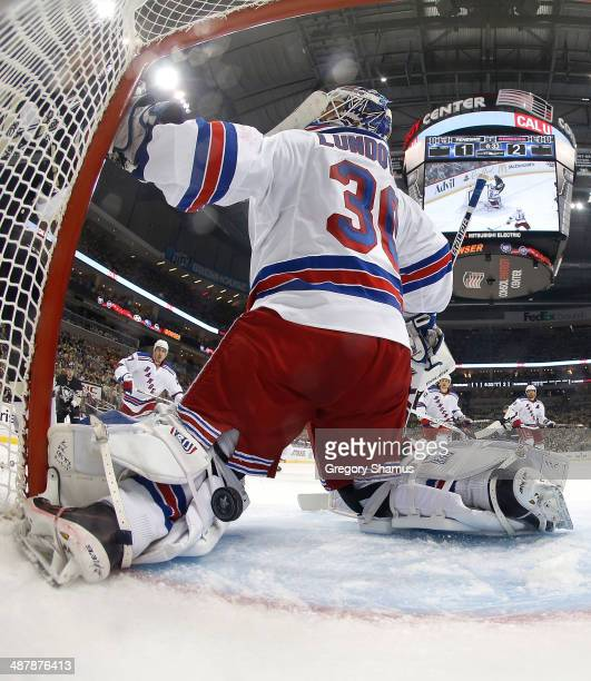 Henrik Lundqvist of the New York Rangers can't stop a shot by James Neal of the Pittsburgh Penguins in Game One of the Second Round of the 2014...