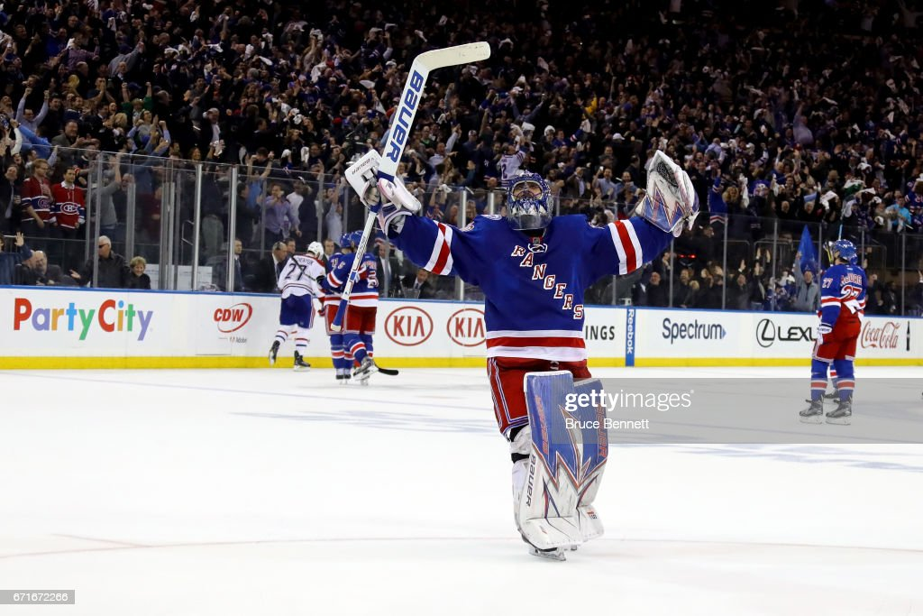 Henrik Lundqvist #30 of the New York Rangers celebrates teammate Derek Stepan #21 empty net goal against the Montreal Canadiens during the third period in Game Six of the Eastern Conference First Round during the 2017 NHL Stanley Cup Playoffs at Madison Square Garden on April 22, 2017 in New York City.