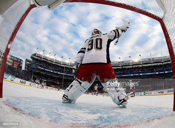Henrik Lundqvist of the New York Rangers celebrates their 7 to 3 win over the New Jersey Devils during the 2014 Coors Light NHL Stadium Series at...