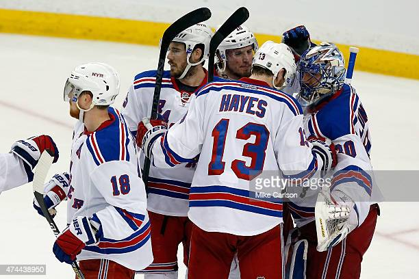 Henrik Lundqvist of the New York Rangers celebrates with his teammates after defeating the Tampa Bay Lightning 5 to 1 in Game Four of the Eastern...
