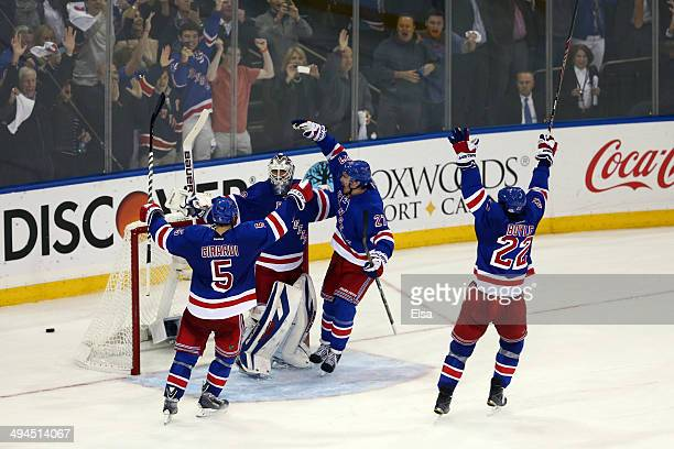 Henrik Lundqvist of the New York Rangers celebrates with his teammates after defeating the Montreal Canadiens in Game Six of the Eastern Conference...