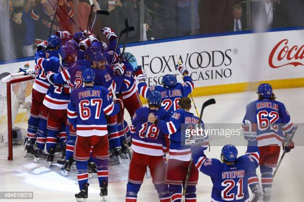 Henrik Lundqvist of the New York Rangers celebrates with his teammates after defeating the Montreal Canadiens in Game Six to win the Eastern...