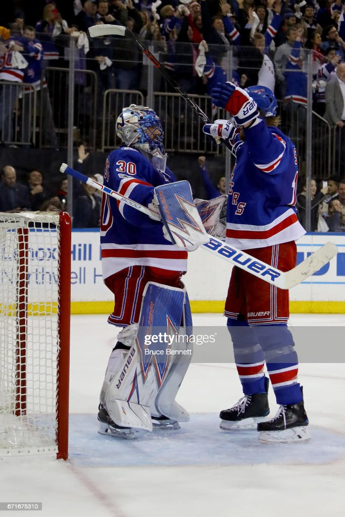 Henrik Lundqvist #30 of the New York Rangers celebrates with teammate Marc Staal #18 after defeating the Montreal Canadiens in Game Six of the Eastern Conference to win the First Round with a score of 3 to 1 during the 2017 NHL Stanley Cup Playoffs at Madison Square Garden on April 22, 2017 in New York City.