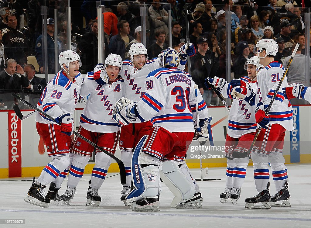 Henrik Lundqvist #30 of the New York Rangers celebrates with teammates after a 4-3 shootout win over the Pittsburgh Penguins on February 7, 2014 at Consol Energy Center in Pittsburgh, Pennsylvania.