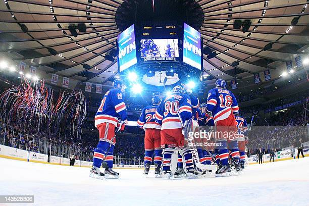 Henrik Lundqvist of the New York Rangers celebrates with teammates after their 3 to 1 win over the Washington Capitals in Game One of the Eastern...