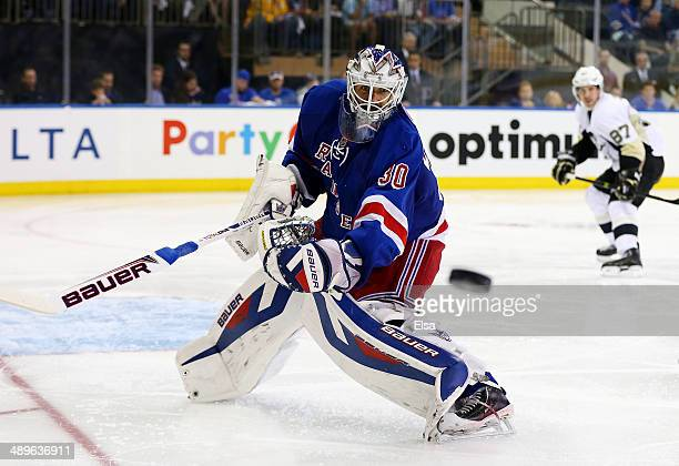 Henrik Lundqvist of the New York Rangers clears the puck in the third period against the Pittsburgh Penguins during Game Six of the Second Round of...
