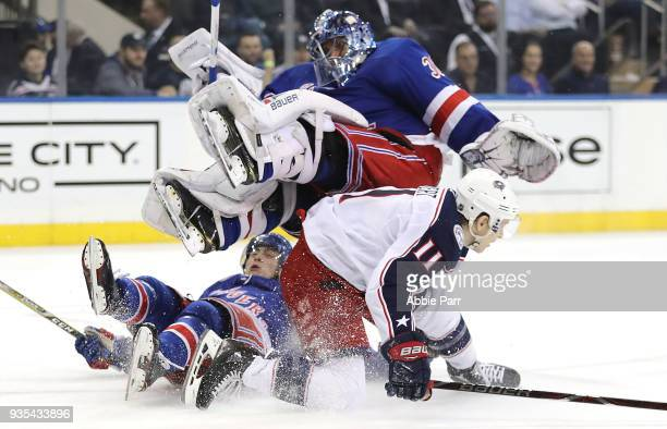 Henrik Lundqvist of the New York Rangers collides with Matt Calvert of the Columbus Blue Jackets in the third period during their game at Madison...