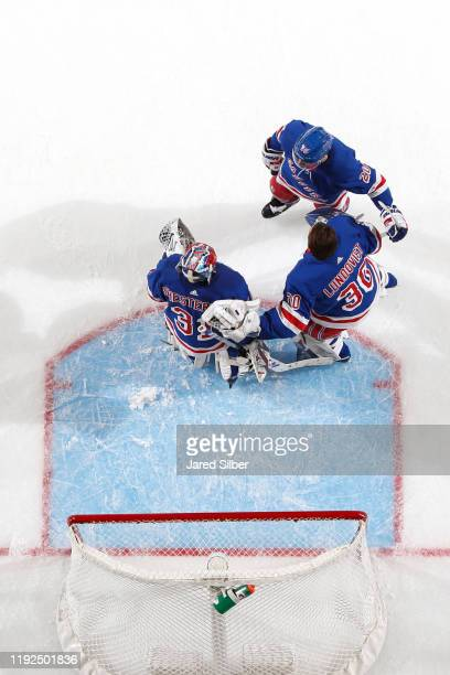 Henrik Lundqvist of the New York Rangers congratulates Igor Shesterkin after he gets the first win of his NHL career against the Colorado Avalanche...