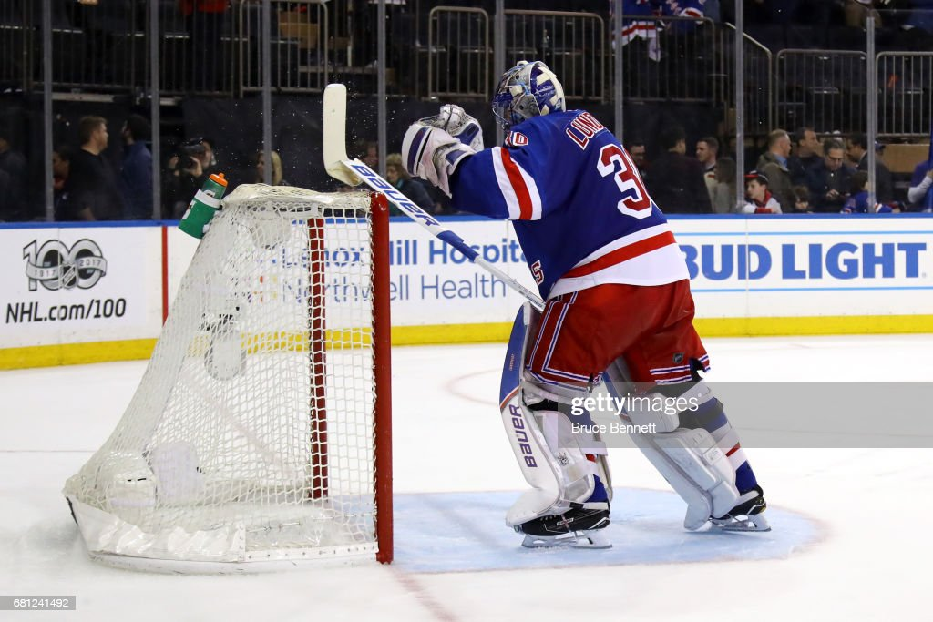 Henrik Lundqvist #30 of the New York Rangers cracks his stick over the cross bar after Jean-Gabriel Pageau #44 of the Ottawa Senators scored an open net goal during the third period in Game Six of the Eastern Conference Second Round during the 2017 NHL Stanley Cup Playoffs at Madison Square Garden on May 9, 2017 in New York City.