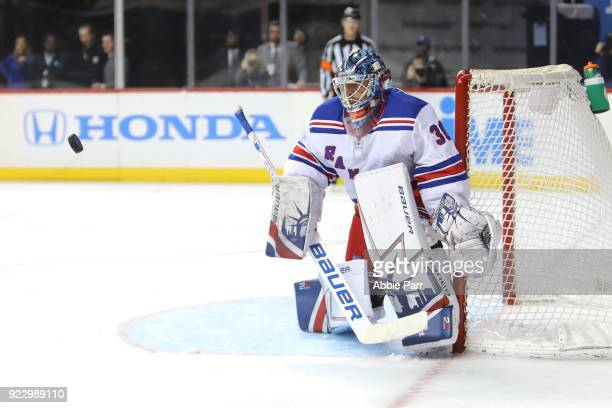 Henrik Lundqvist of the New York Rangers defends the goal from a shot in the second period against the New York Islanders during their game at...
