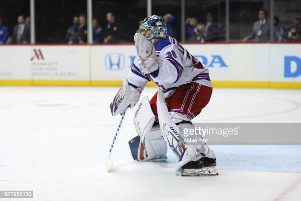 Henrik Lundqvist of the New York Rangers defends the goal in the second period against the New York Islanders during their game at Barclays Center on...