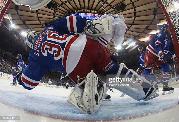 Henrik Lundqvist of the New York Rangers defends the net against Brian Gionta of the Montreal Canadiens during Game Six of the Eastern Conference...