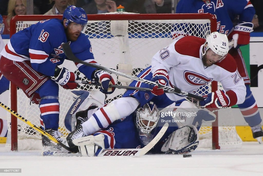 Henrik Lundqvist #30 of the New York Rangers defends the net against Thomas Vanek #20 of the Montreal Canadiens during Game Six of the Eastern Conference Final in the 2014 NHL Stanley Cup Playoffs at Madison Square Garden on May 29, 2014 in New York City. Rangers defeated the Canadiens 1-0.