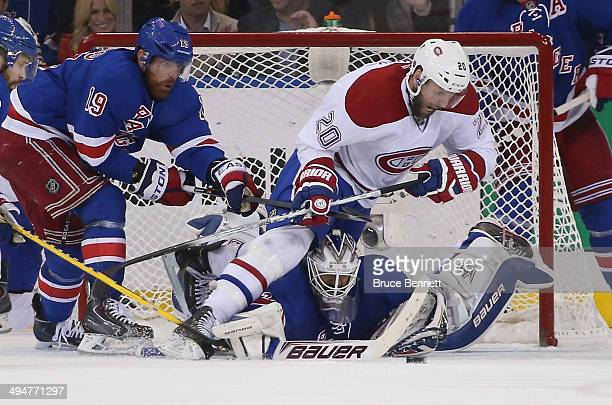 Henrik Lundqvist of the New York Rangers defends the net against Thomas Vanek of the Montreal Canadiens during Game Six of the Eastern Conference...