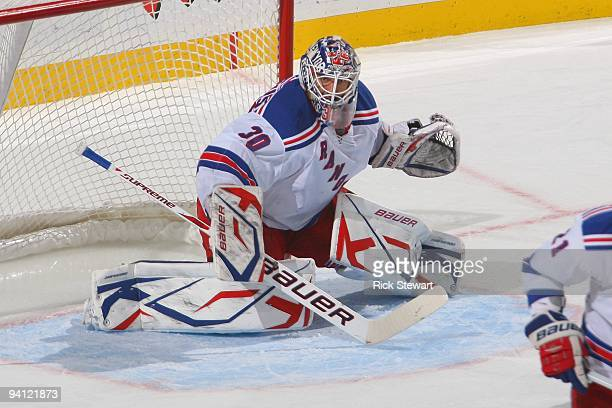 Henrik Lundqvist of the New York Rangers defends the net during the game against the Buffalo Sabres at HSBC Arena on December 5, 2009 in Buffalo, New...