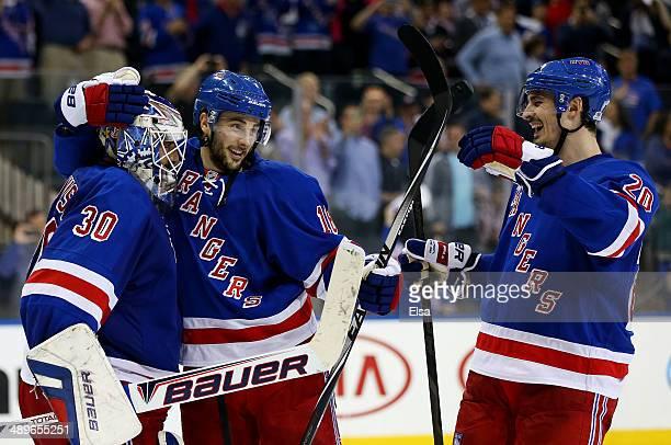 Henrik Lundqvist of the New York Rangers Derick Brassard of the New York Rangers and Chris Kreider of the New York Rangers celebrate their 3 to 1 win...