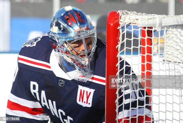 Henrik Lundqvist of the New York Rangers follows the play during the 2018 Bridgestone NHL Winter Classic against the Buffalo Sabres at Citi Field on...