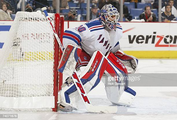 Henrik Lundqvist of the New York Rangers gets set to make a save against the Buffalo Sabres in Game 1 of the Eastern Conference Semifinals during the...