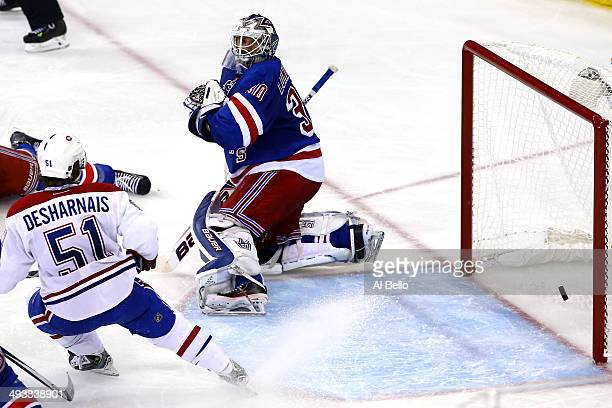 Henrik Lundqvist of the New York Rangers gives up a goal to Francis Bouillon of the Montreal Canadiens in the second period during Game Four of the...