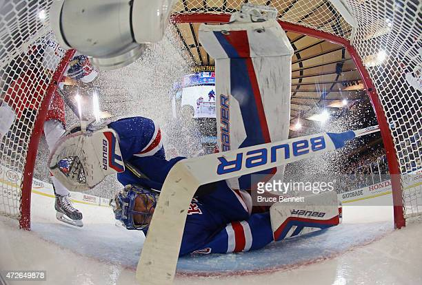 Henrik Lundqvist of the New York Rangers gives up a third period goal to Curtis Glencross of the Washington Capitals in Game Five of the Eastern...