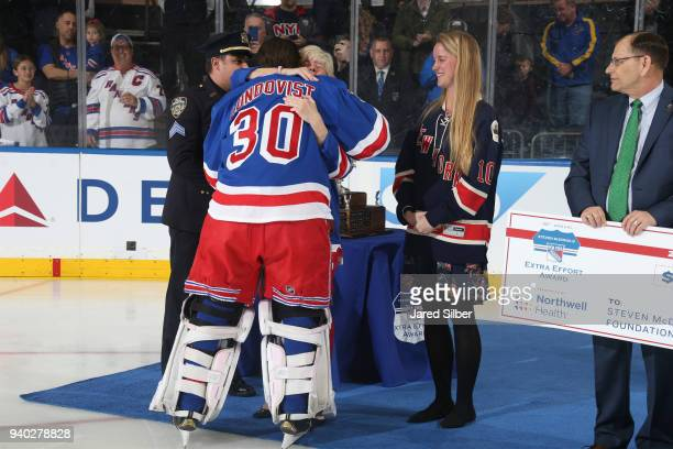 Henrik Lundqvist of the New York Rangers greets Patti Ann McDonald wife of Steven McDonald after being named the winner of the 20172018 Steven...