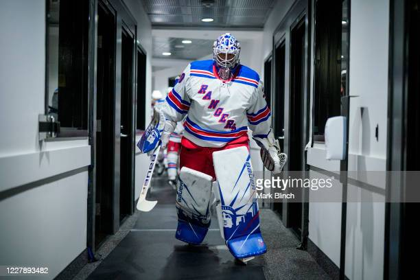 Henrik Lundqvist of the New York Rangers heads to the dressing room before facing the Carolina Hurricanes in Game Two of the Eastern Conference...