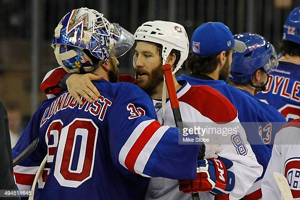 Henrik Lundqvist of the New York Rangers hugs Brandon Prust of the Montreal Canadiens after defeating the Montreal Canadiens in Game Six to win the...