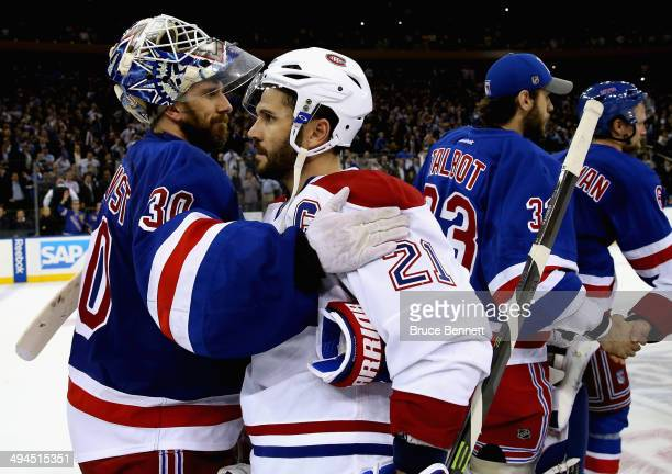 Henrik Lundqvist of the New York Rangers hugs Brian Gionta of the Montreal Canadiens after winning Game Six of the Eastern Conference Final in the...
