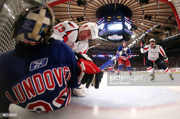 Henrik Lundqvist of the New York Rangers is beaten by Viktor Kozlov of the Washington Capitals as Alex Ovechkin celebrates the score at 9:21 of the...