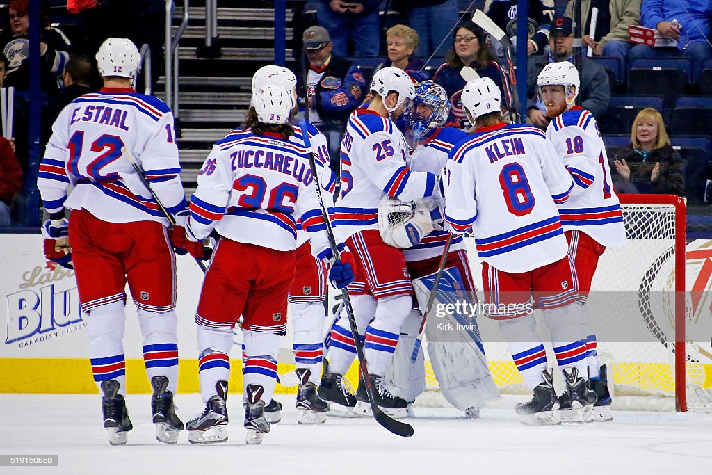 Henrik Lundqvist #30 of the New York Rangers is congratulated by his teammates after defeating the Columbus Blue Jackets 4-2 on April 4, 2016 at Nationwide Arena in Columbus, Ohio.