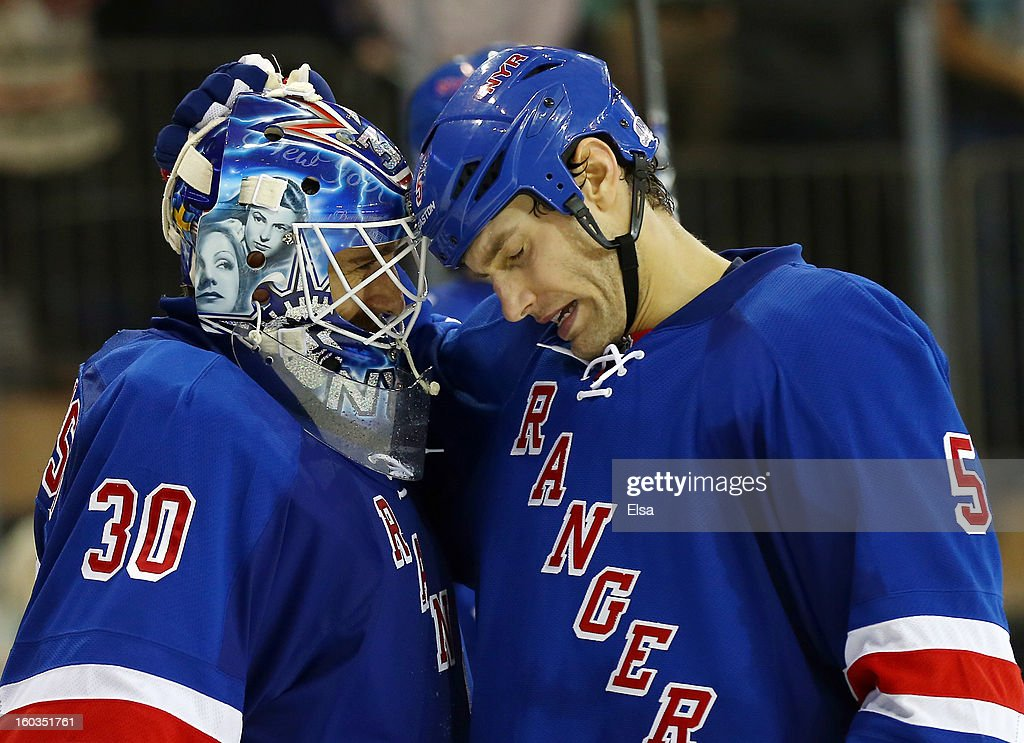 Henrik Lundqvist #30 of the New York Rangers is congratulated by teamamte Dan Girardi #5 after the win over the Philadelphia Flyers on January 29, 2013 at Madison Square Garden in New York City. The New York Rangers defeated the Philadelphia Flyers 2-1.