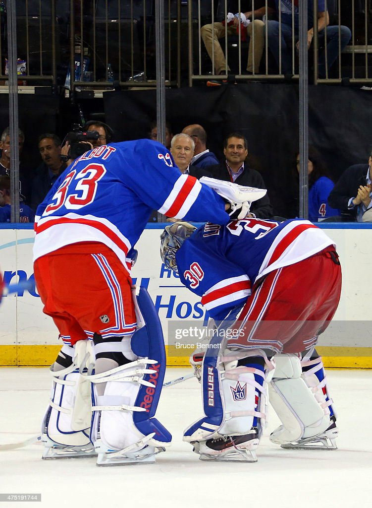 Henrik Lundqvist #30 of the New York Rangers is consoled by teammate Cam Talbot #33 after losing against the Tampa Bay Lightning by a score of 2-0 in Game Seven of the Eastern Conference Finals during the 2015 NHL Stanley Cup Playoffs at Madison Square Garden on May 29, 2015 in New York City.