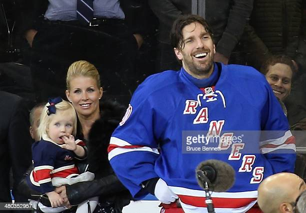 Henrik Lundqvist of the New York Rangers is joined by his wife Therese and daughter Charlise as the Rangers honor him prior to the game against the...