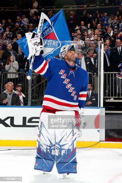 Henrik Lundqvist of the New York Rangers is named the first star of the game after a 3-2 win against the Carolina Hurricanes at Madison Square Garden...