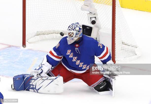 Henrik Lundqvist of the New York Rangers is unable to stop a shot by Devon Toews of the New York Islanders in the third period during an exhibition...