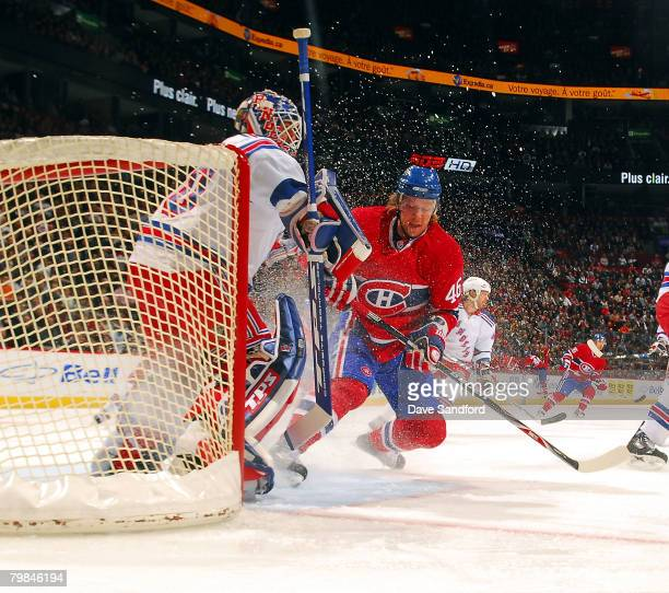 Henrik Lundqvist of the New York Rangers keeps an eye on the play as Andrei Kostitsyn of the Montreal Canadiens stops in the crease at the Bell...