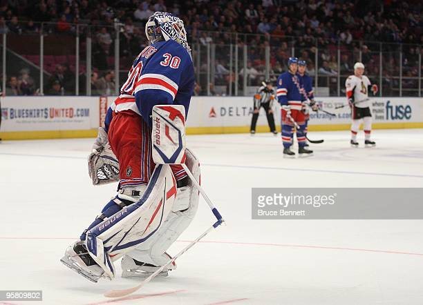 Henrik Lundqvist of the New York Rangers leaves the net after breaking his stick in his game against the Ottawa Senators at Madison Square Garden on...