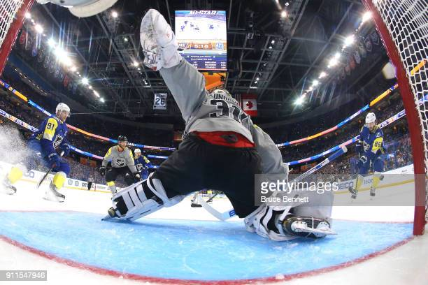 Henrik Lundqvist of the New York Rangers looks for a block in the second half during the 2018 Honda NHL AllStar Game between the Atlantic Division...