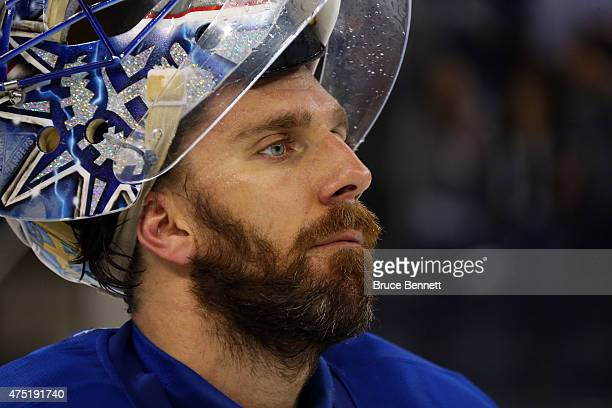 Henrik Lundqvist of the New York Rangers looks on after losing against the Tampa Bay Lightning by a score of 2-0 in Game Seven of the Eastern...