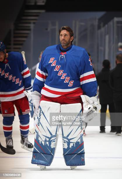 Henrik Lundqvist of the New York Rangers looks on after the ceremonial handshake after Game Three of the Eastern Conference Qualification Round prior...