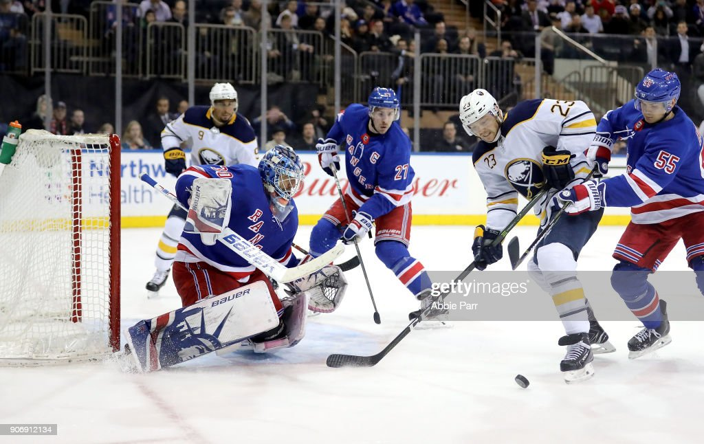 Henrik Lundqvist #30 of the New York Rangers looks to block a shot by Sam Reinhart #23 of the Buffalo Sabres in the third period during their game at Madison Square Garden on January 18, 2018 in New York City.
