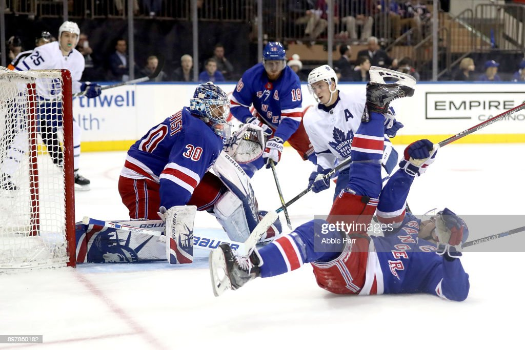 Henrik Lundqvist #30 of the New York Rangers looks to block a shot against the Toronto Maple Leafs in the third period during their game at Madison Square Garden on December 23, 2017 in New York City.