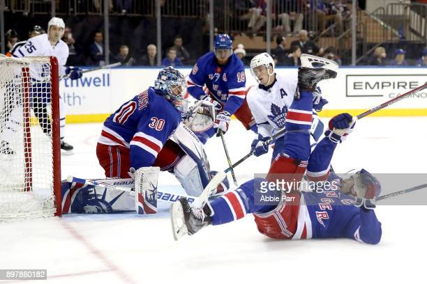 Henrik Lundqvist of the New York Rangers looks to block a shot against the Toronto Maple Leafs in the third period during their game at Madison...