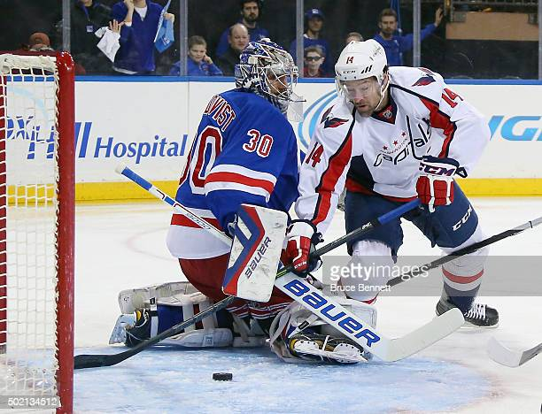 Henrik Lundqvist of the New York Rangers makes a first period svae on Justin Williams of the Washington Capitals at Madison Square Garden on December...