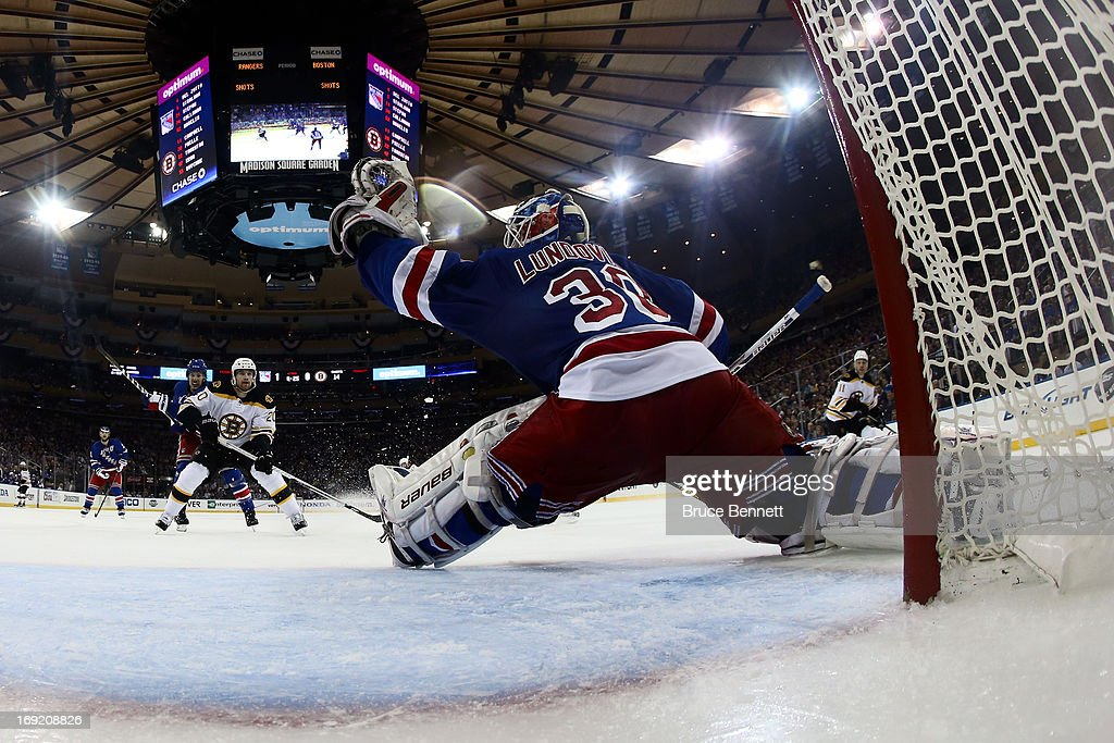 Henrik Lundqvist #30 of the New York Rangers makes a glove save against the Boston Bruins in Game Three of the Eastern Conference Semifinals during the 2013 NHL Stanley Cup Playoffs at Madison Square Garden on May 21, 2013 in New York City.