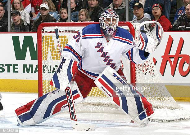 Henrik Lundqvist of the New York Rangers makes a glove save against the Ottawa Senators on his way to a shutout at Scotiabank Place on January 10...