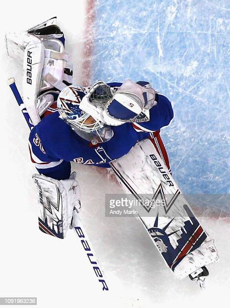 Henrik Lundqvist of the New York Rangers makes a glove save during the game against the New Jersey Devils at Prudential Center on January 31, 2019 in...