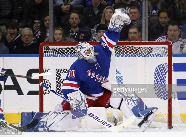 Henrik Lundqvist of the New York Rangers makes a mask save against the Florida Panthers at Madison Square Garden on November 10, 2019 in New York...