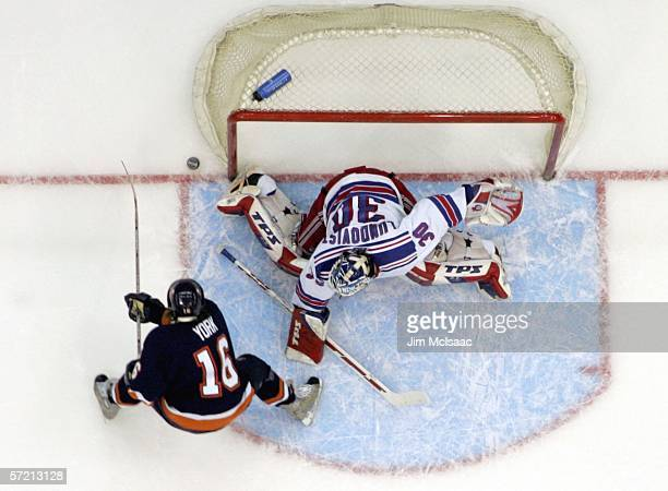Henrik Lundqvist of the New York Rangers makes a save against Mike York of the New York Islanders during their game on March 29 2006 at Nassau...