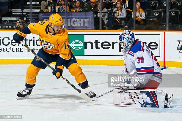 Henrik Lundqvist of the New York Rangers makes a save against Nick Bonino of the Nashville Predators during the first period at Bridgestone Arena on...